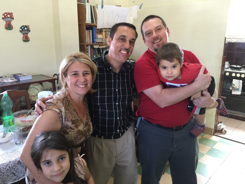Dennis with Abdiel, Leza, and their two children in their home on Sunday afternoon.